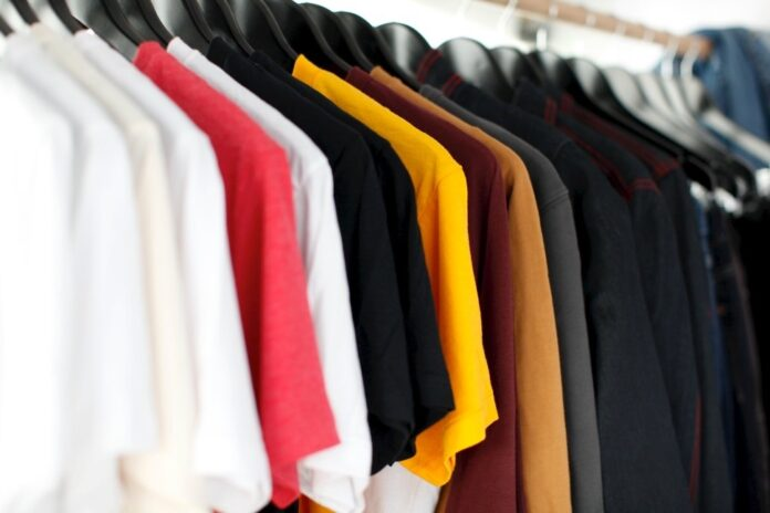 Coloured shirts hanging on rack in store