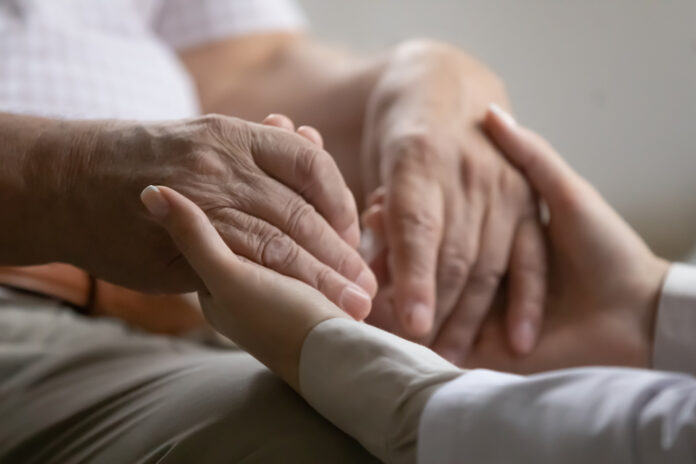 Adult Cancer Patient Holding Hands